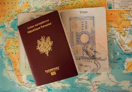 World map in the background with a passport on the top and to the right of the passport a visa.